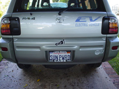 Picture of back end of Toyota RAV4 EV and customized license plate, SUN PWRD.