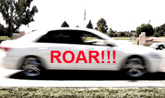 picture of a moving white car with word ROAR on it.