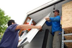 The first solar panel comes off the truck!