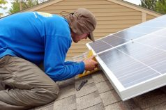 Tim works to true and align the first two solar panels.