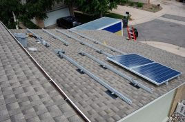 The garage roof begins to stack up panels -- two in this photo.