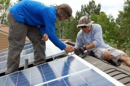 Tim (left) and Dustin (right) test to make sure the upper string of panels is making electricity. It is -- lots of it!
