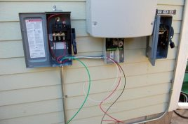 The wiring is hanging out of the inverter and AC Disconnect at 5:30 p.m. on Day 2.
