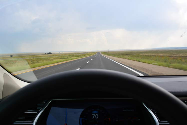 No other cars -- or gas stations -- on this lonely section of I-25 in Northern Mexico, but plenty of confidence that I wouldn't run out of charge in my brother's Tesla Model S. [Photo by Christof Demont-Heinrich]