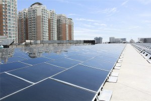 A solar array on top of an IKEA store. [Flickr Creative Commons Photo By The Climate Group]