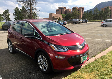 Red Chevy Bolt parked at NCAR