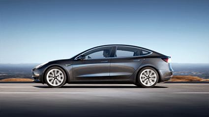 A Tesla Model 3 in motion