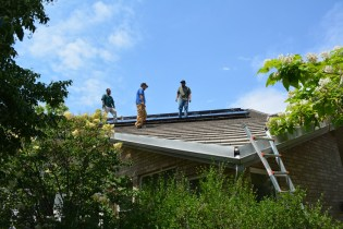 Sopris Solar workers survey their work on Day 4.