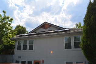 The first row of solar panels on the east roof of the Common House.