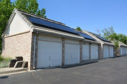 The first row of solar panels on the garages has been installed at the end of Day 5.