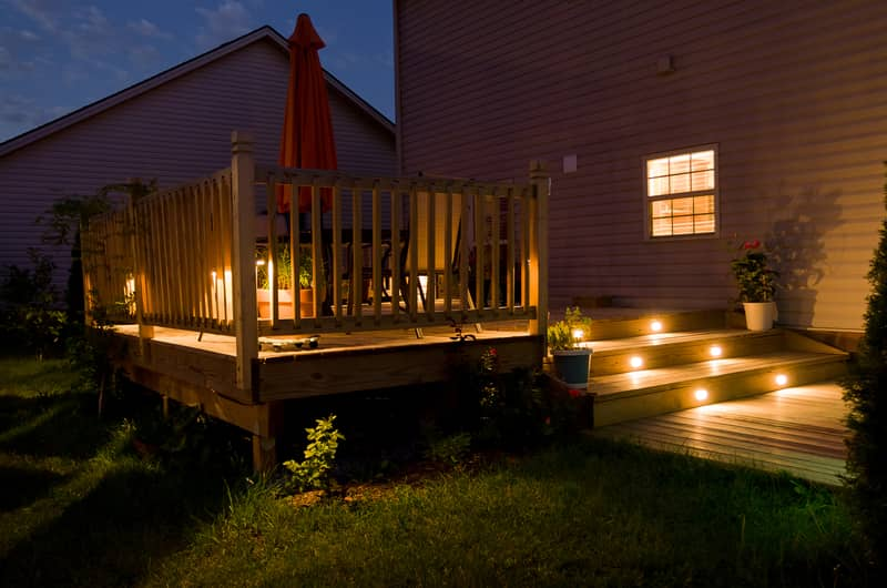 solar lights illuminating a wooden deck