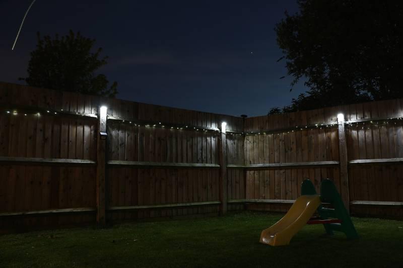 best solar lights illuminating fence at night