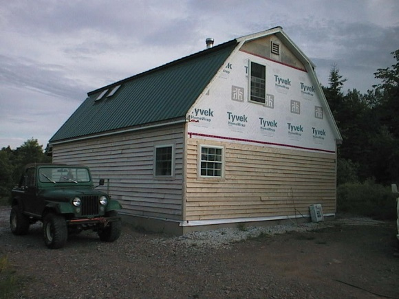 This is the view of our house from the north side. Note that nothing is finished...not the siding, not the landscaping...not anything. At least the Jeep looks good.