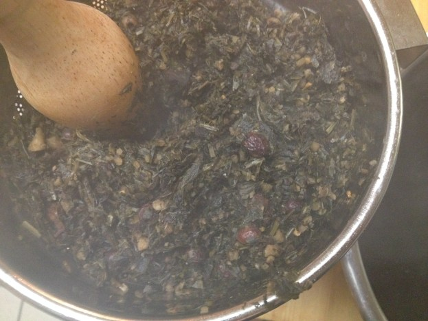 Pressing the cooked herbs