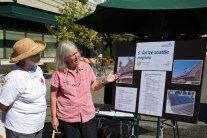 One woman showing Solarize Northwest information to another