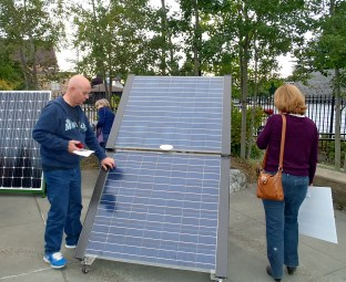 participants view a solar panel at Solarize Southwest