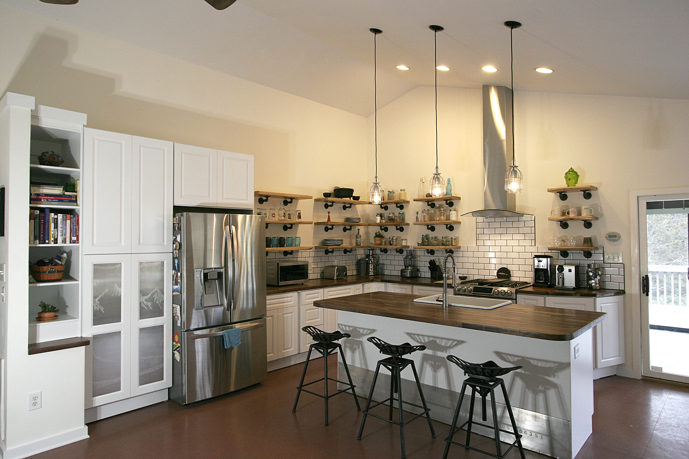 Open Concept Kitchen With Natural Elements And Industrial Touches