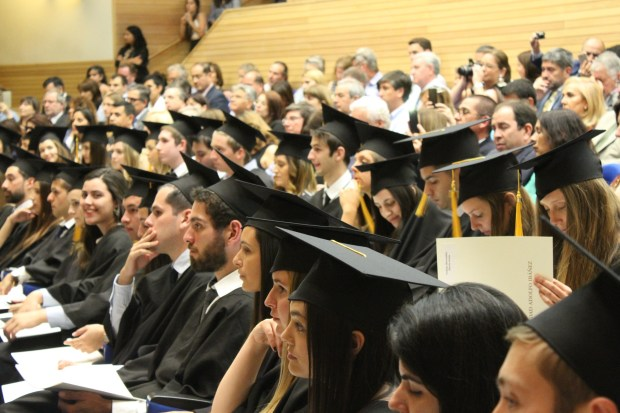 Photo of university students in academic gowns