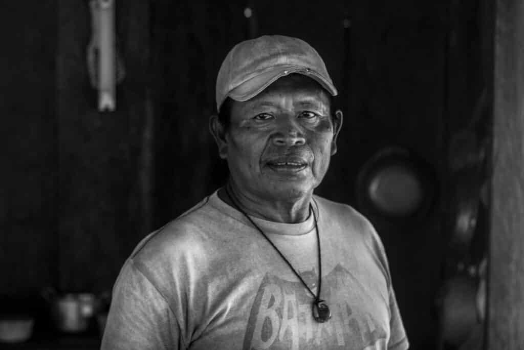 Rutilio Milton poses with a batman t shirt in black and white in Bahia Honda of Bocas del Toro Panama