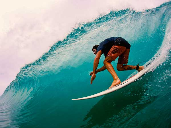 surfer riding the tube at bluff beach in bocas del toro