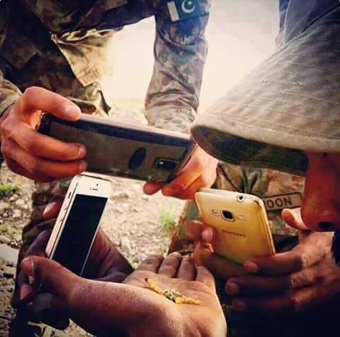 soldiers taking selfie of scorpion