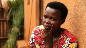 woman's story - pensive in African village