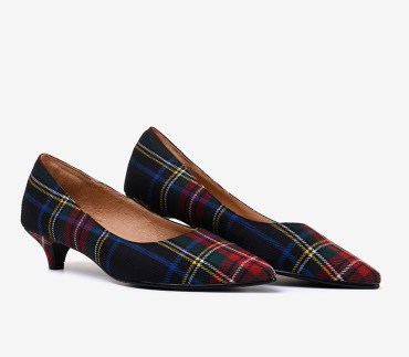 A picture of a pair of tartan kitten heels, providing inspiration for thanksgiving dinner