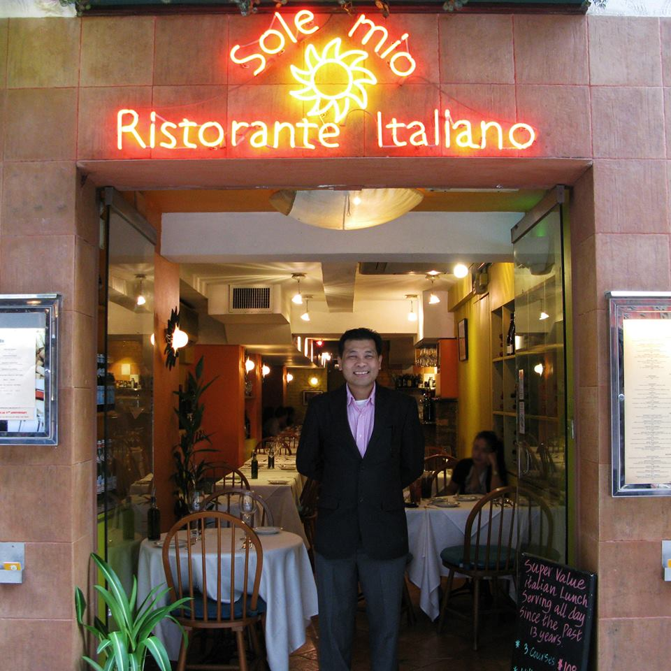 The chef Mr. In standing in front of his restaurant