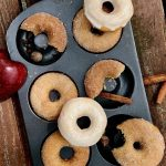 baked apple cider donuts in a cinnamon sugar coating