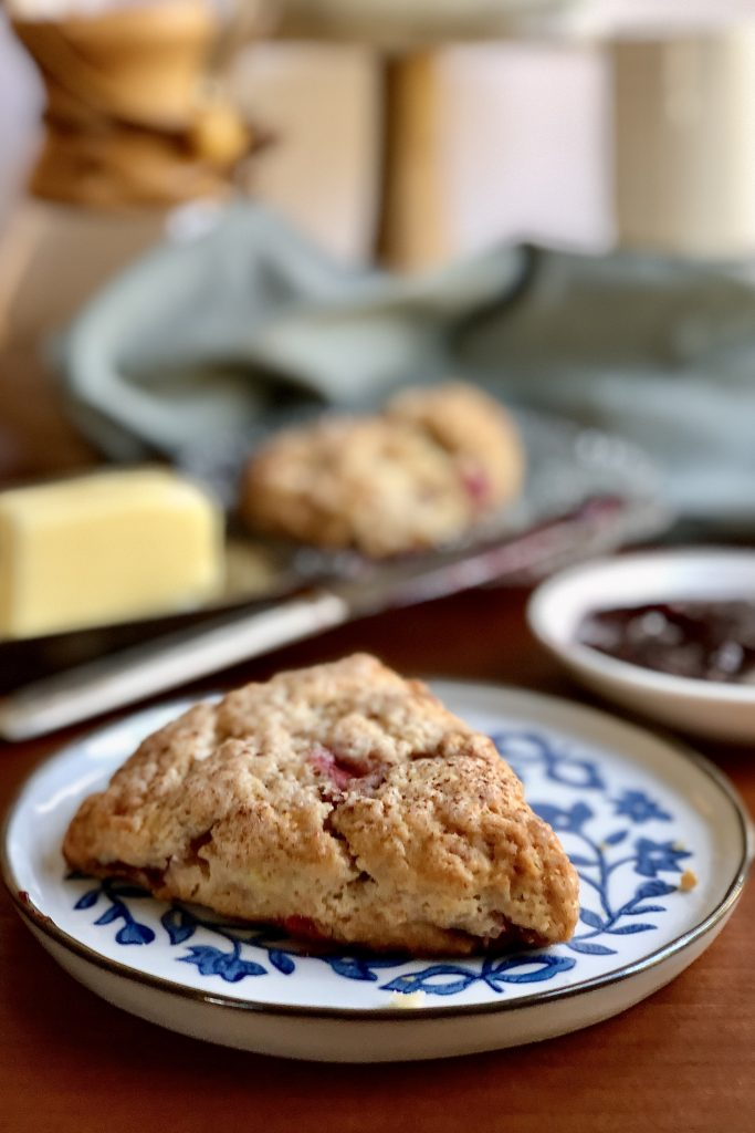 Strawberry scones with butter, jam and coffee.