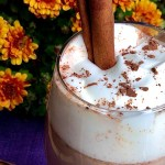 mexican hot chocolate topped with whipped cream and a cinnamon stick