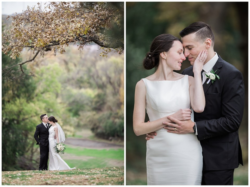 Couple kissing each other under a tree on the day of their fall wedding.