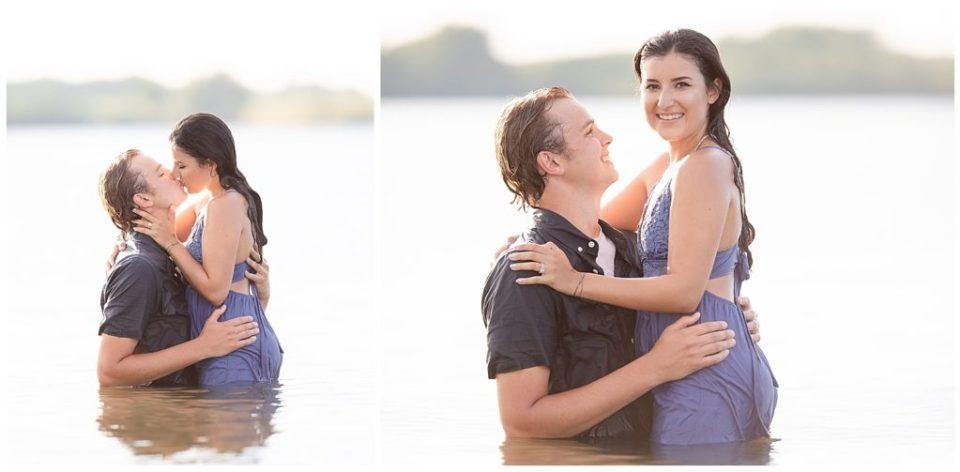 Engaged couple smiling at the camera at Wall Lake, South Dakota during engagement session at sunset