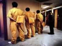 PBSP Against wall shackled together [photo courtesy of CDCR]