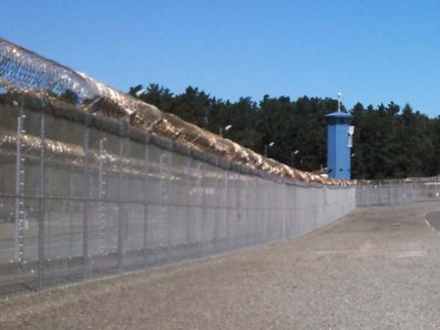 Pelican Bay prison tower and perimeter fence. (Credits: Capital Public Radio / Katie Orr)