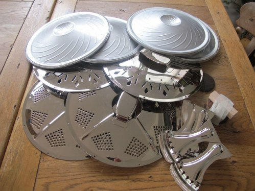 Delivery of nice shiny parts, ready to be made into Sollophonic solid bodied resonator guitar conversions. Continental cones, maple saddles and rosewood biscuits, Chicken-foot and sieve coverplates and matching tailpieces.