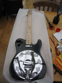 """All Black Sollophonic with Chickenhead controls. This has a standard Tele neck pickup. Customer quote """"Very happy with it. Great piece of kit for anyone interested in country blues and slide. Everybody who is into slide should have one!"""""""