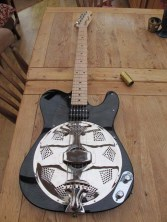 """Squier Affinity Tele converted into a Sollophonic. Jagmaster pickup and black pickguard. Customer comments """"Its brilliant....amazed me how good the acoustic sound is....when practising this is a bonus. Thanks for the guitar Andy, dont know how you do them for the price"""""""