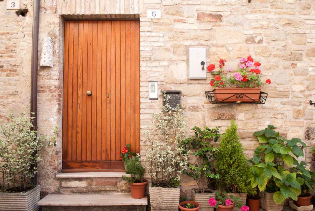 Flower-covered doorway in Bevagna