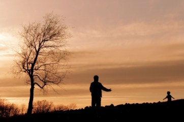 2853097 - silhouette of a parent opening his arms to a child running toward him