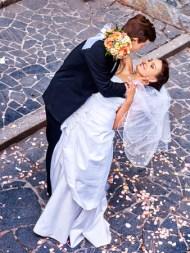 38740256 - groom carries his bride over back. outdoor.
