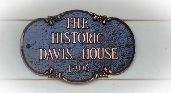 Antiqued bronze sign saying The Historic Davis House 1906