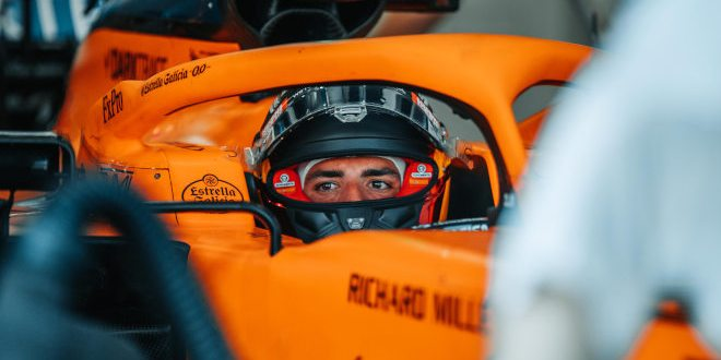 Carlos Sainz, McLaren, in cockpit with visor raised