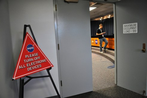 NASA Media Auditorium, Turn Off Electronics. Oops! Kennedy Space Center, Fla., Nov. 26, 2011