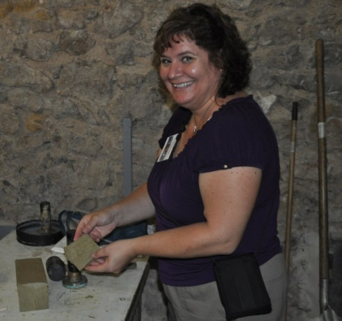 Me After I Sliced and Stamped My Own Slab of Marseille Soap at the Marius Fabre Soap Factory