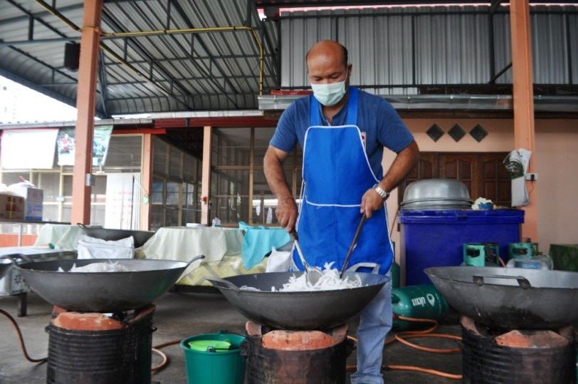 Strips of coconut are mixed with boiling water and sugar in Chiang Khan located in Thailand's northeast province of Loei.