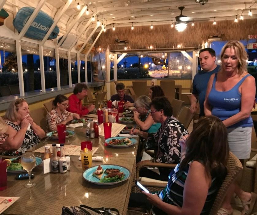 The Group Enjoys the SandBar Tiki & Grille's Smoked Barbecue.