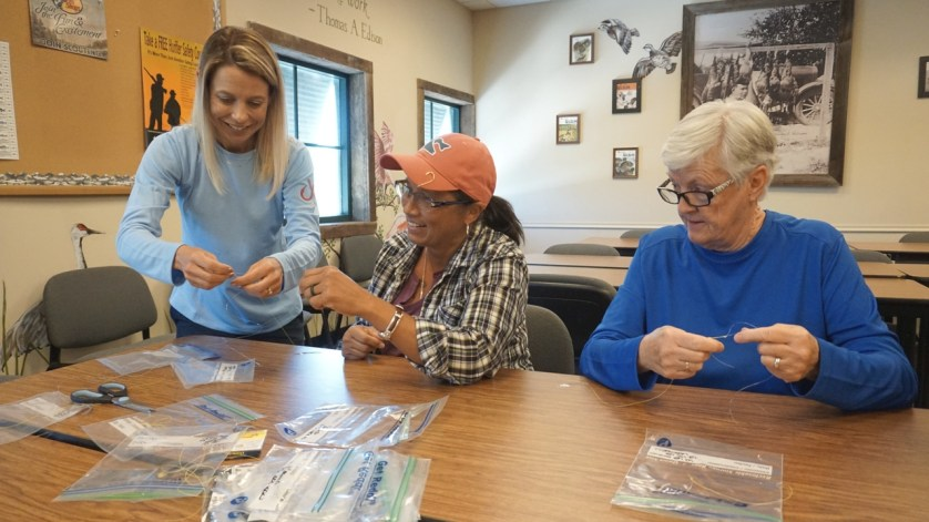 Debbie Hanson of SheFishes2 Shows Participants How to Tie Knots During a Frehwater Fishing Seminar She Led in Ft. Myers, April, 2017.