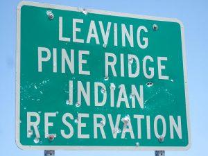 029-US_NativeAmericanWomenVAW_PineRidgeRezSign