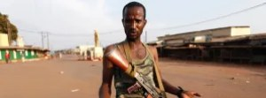 Seleka fighter Cisco gestures outside a mosque where bodies of people killed during fighting are gathered in Bangui